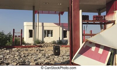 Old dirty gas station road 66. Abandoned gas oil station end of fuel the world apocalypse petrol slow motion video