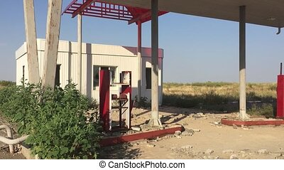 Old dirty gas station road 66. Abandoned gas station end of the world apocalypse petrol fuel slow motion video