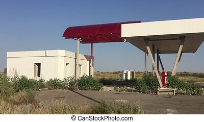 Old dirty gas station road 66. Abandoned gas station end of the world fuel apocalypse petrol oil slow motion video
