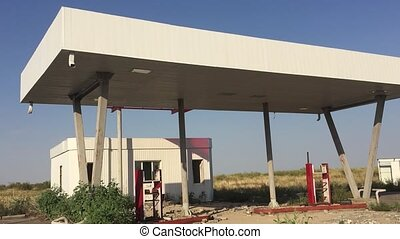 Old dirty gas station road 66. Abandoned gas station end of the world fuel apocalypse petrol slow motion video