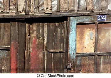 old dirty wooden door locked