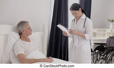 Old disabled person in hospital - Asian Nurse Taking Care...
