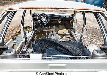 disassembled car at an automobile junkyard