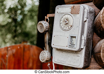 old disk payphone phone close up