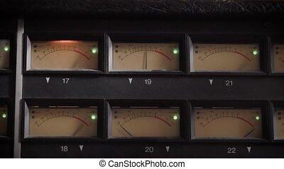 old displays of professional analog vu metres in a recording...