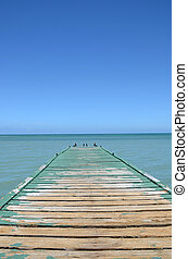 Old Dock - weathered dock over tropical blue water
