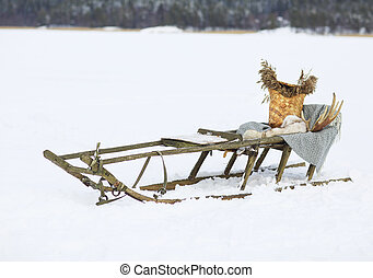 Old dog sled in tundra with decoration