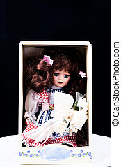 Old doll in the box