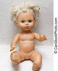 old doll on a white background