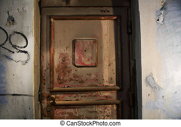 old door. Abandoned grungy interior