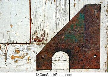 Old door corner armed with iron strap