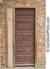 Old door in brick wall