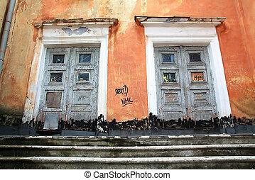 old door in destroyed building