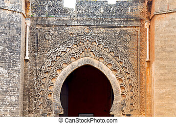 old door in morocco africa ancien and wall ornate yellow -...