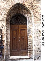 old door in San Gimignano, Tuscany. Italy