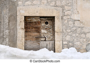 Old door in the snow