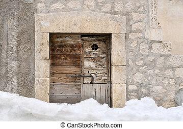 Old door in the snow