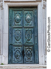 Green old copper door in Venice Italy
