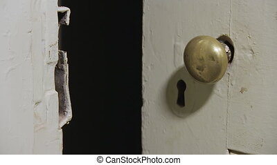 Old door knob shot - A medium shot of a door knob
