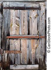 old door made of wooden boards closeup
