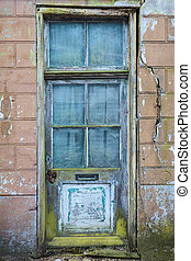 Old door of an abandoned house