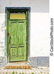 Old door - Old green awry door at grunge house