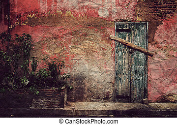 Old door on red wall ,Vintage style