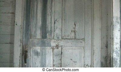 Old Door Opens by Itself - Old barn farm door that is...