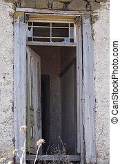 Old Door - Old wooden door fram in a rendered stone cottage....