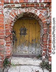 old door - An old wooden door in brick wall