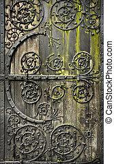 Old door - Old rotten wooden door with moss
