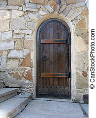 Old door in the stone wall