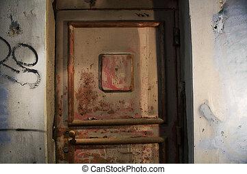 old door.Abandoned grungy interior