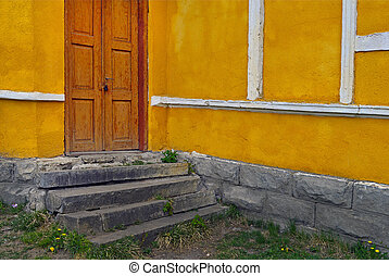 Old doors on a yellow wall