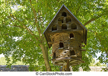 old dovecote made of wood and straw at  a farmstead