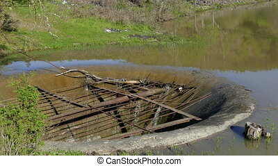Old Drainage System In A Lake At Summer - A drainage system...