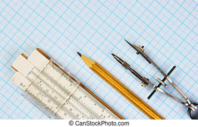 Old drawing tools on graph paper