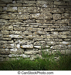 old dry stone wall in rural setting