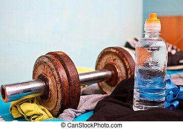Old dumbbells,water bottle  and sneakers