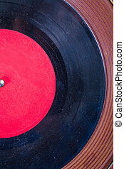 Old dusted vinyl record on Turntable very close up view