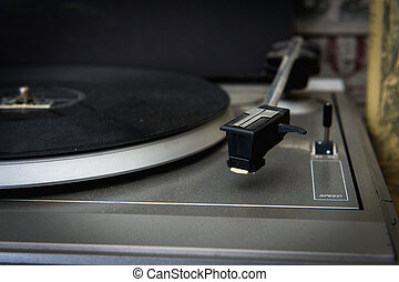 Old dusty turntable detail with vinyl disc