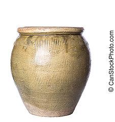 Old earthenware storage jar over white background