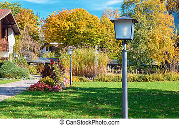 Old electric street lamps in autumn park in Germany