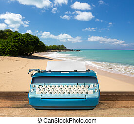 Old electric typewriter on wood table with ocean background