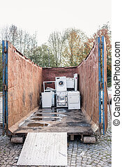 Old electrical appliances in container of recycling center -...