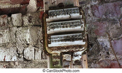 Old electrical panel on the brick wall.