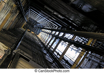 Old Elevator Shaft - View up an old freight elevator shaft.