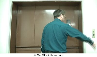 Old Elevators Being Opened - Businessman pushes button and...