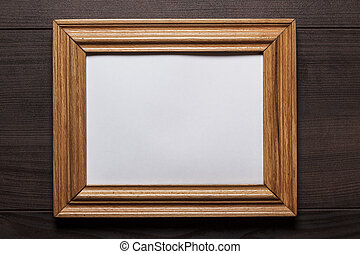 old empty frame on wooden wall