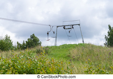 Old empty ski lift in summer landscape